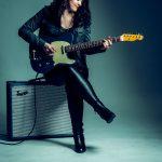 Lindsey Miller playing guitar