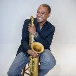 Jovan Quallo with saxophone